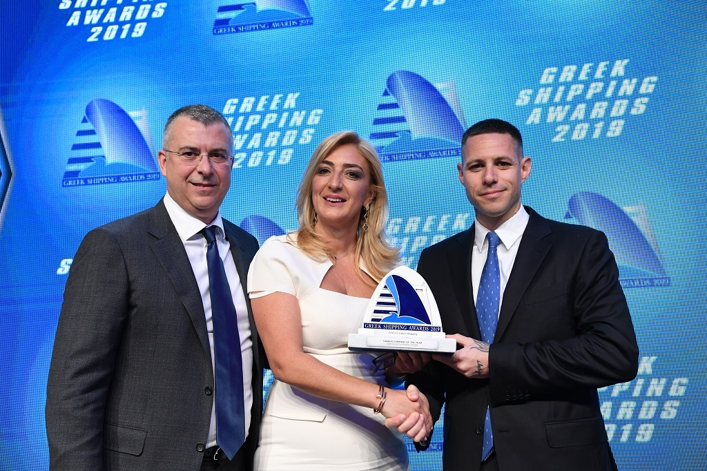 Paillette Palaiologou of sponsor Bureau Veritas presenting the Tanker Company of the Year Award to Paris Kassidokostas-Latsis (right) and George Margaronis of Latsco Shipping.